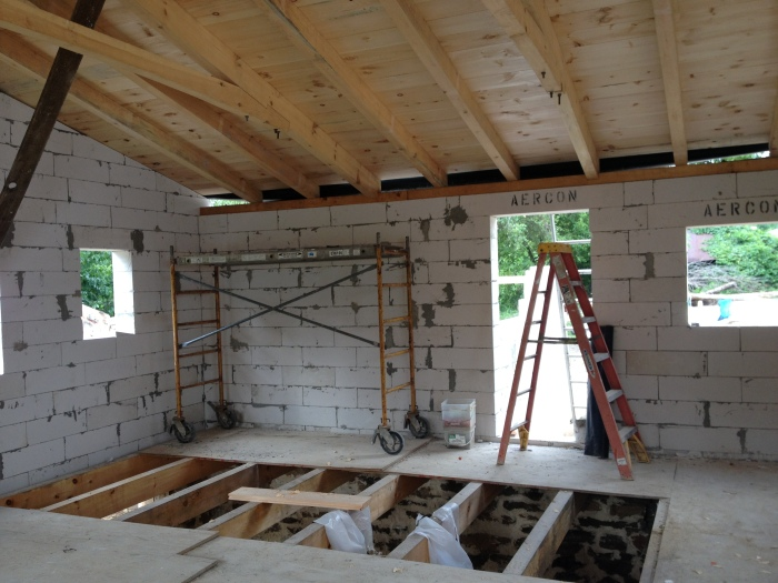 a peek at the truss and rafters on the wooden beam